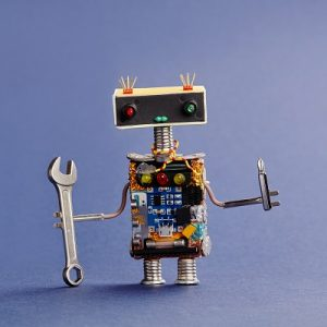 robot holding a bolt and a spanner, symbolising curriculum nuts and bolts