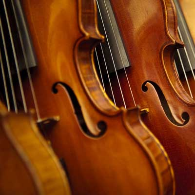 Picture of some violins, symbolising Ensemble Support at GCSE/ ALevel