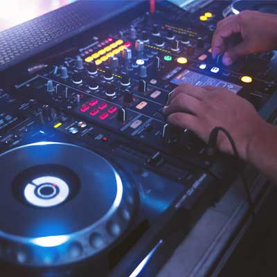 Someone playing DJ decks. Symbolosing DJ / Urban Music Teacher In Residence