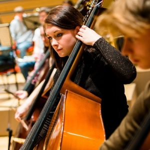 Female musician playing a cello.