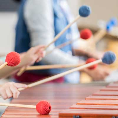 Children playing a xylophone. Symbolises Primary School Curriculum Advisory Visit