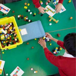 Little boy learning maths with bricks. Representing Teacher Assessment Judgements in Mathematics