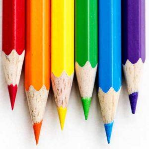 Rainbow crayons in a row.