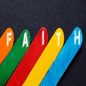 "5 colourful lollipop sticks spelling out the word ""Faith"" representing Understanding RE in Birmingham"