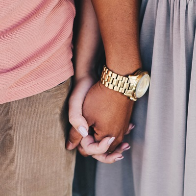 Two people holding hands, symbolising relationship education in primary schools.