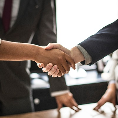 Two people shaking hands - representing dealing effectively with unions