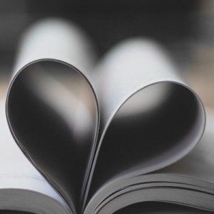 The middle of a book, folded round to look like a heart. To symbolise a love of reading