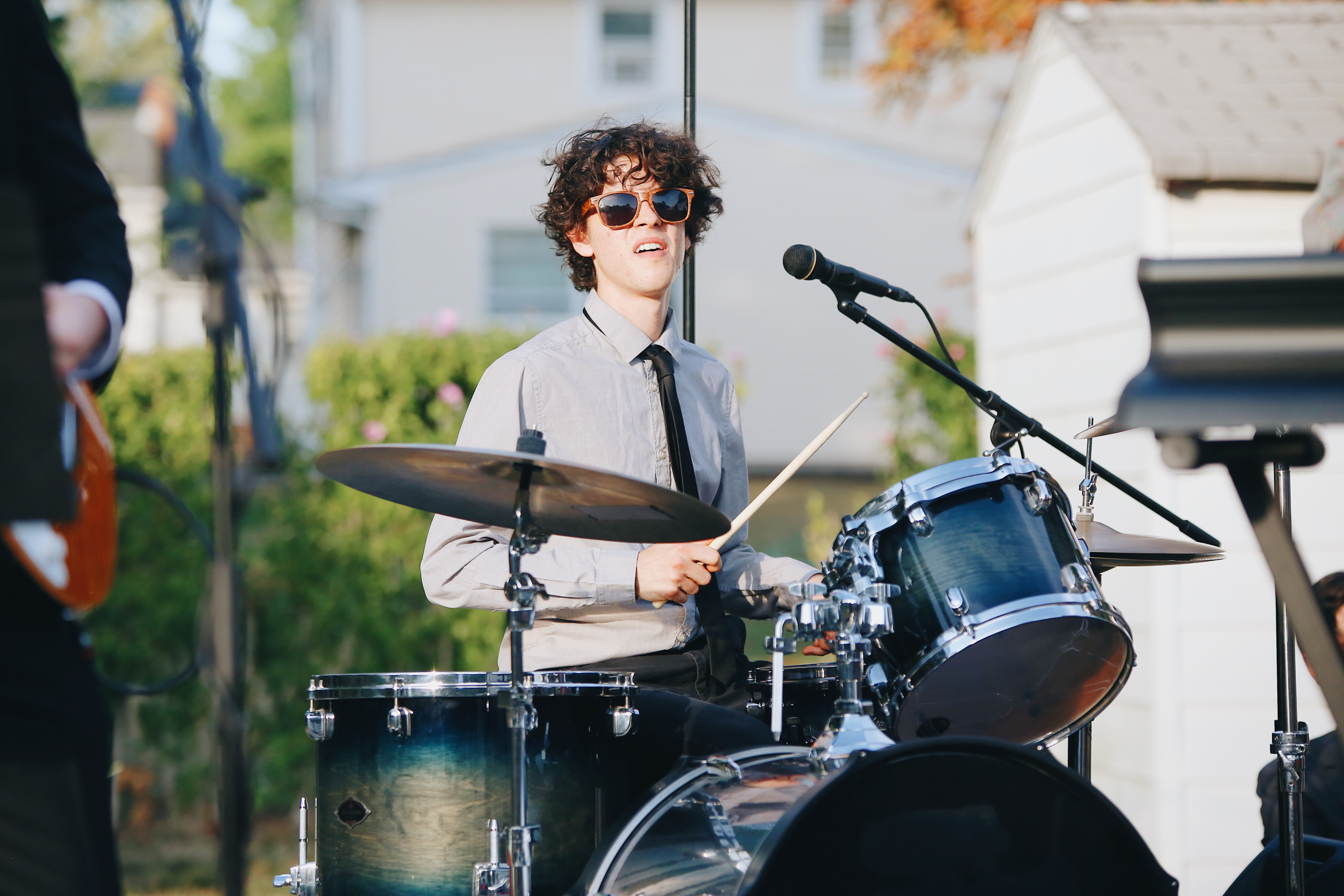 Teenager playing the drums to symbolise drum lessons at a music school.