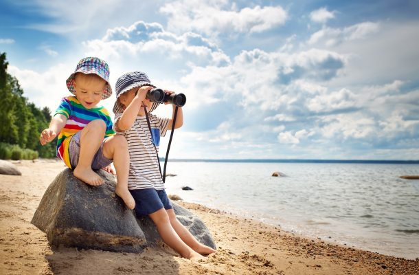 Babygirl and babyboy sitting on the beach in summer hats - 11-Activities-To-Do-With-Children-In-Birmingham-This-Easter