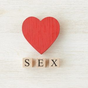 "Heart with scrabble word ""SEX"". Symbolising relationships and sex education"