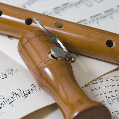 wooden recorder on a sheet of music