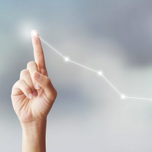 hand pointing up into the sky with a graph line behind it going upwards