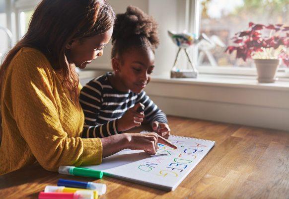 mum teaching child at home