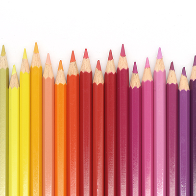 Coloured pencils lined up in a row